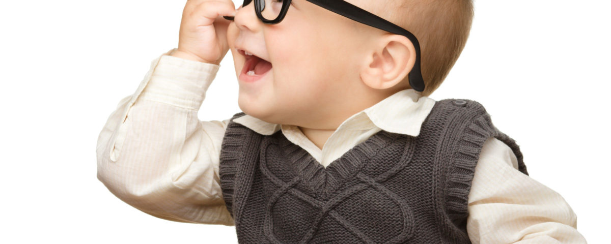 Baby reading and wearing glasses